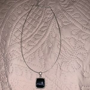 Silver necklace with black accent in center